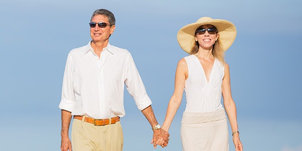 Couple on White Holding Hands Together