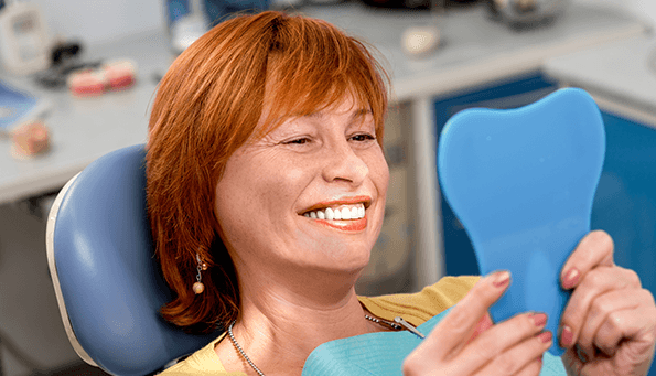 What are the problems with dental implants?